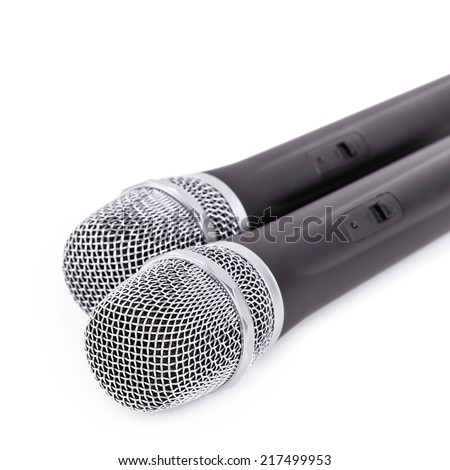 Two cordless microphone closeup on white background
