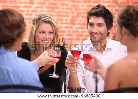 Two couple at a restaurant - stock photo