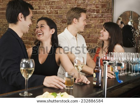 Two Couples Enjoying a Drink - stock photo