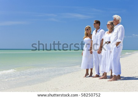 Two couples, generations of a family together holding hands on a tropical beach