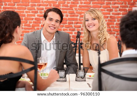 two couples in a restaurant - stock photo