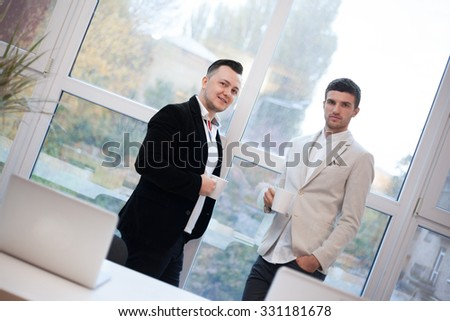 Two coworkers talking in office