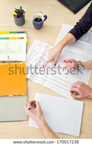 Two coworkers working together on a design brief for a new product application - stock photo
