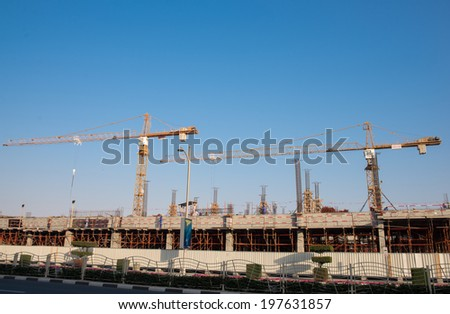 two cranes in construction
