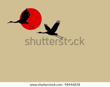 two cranes on brown background - stock photo