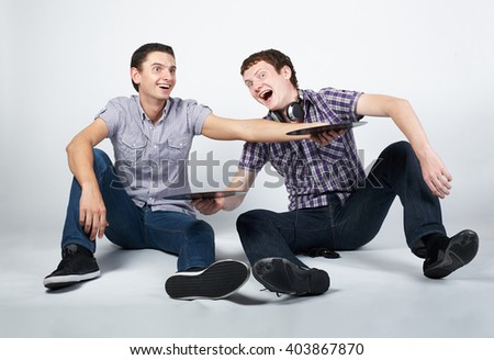 two crazy guys with plates - stock photo
