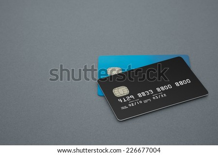 two Credit and Bank Cards on a grey background - stock photo