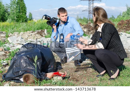 Two criminalists working on a crime scene - stock photo