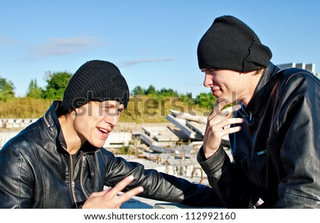 Two criminals discussing robbery plan - stock photo