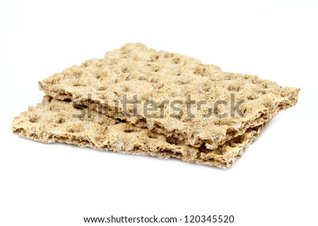 Two crispbread over a plain white background. - stock photo