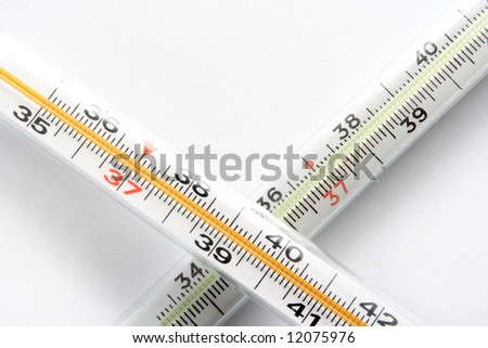 Two crossed thermometers