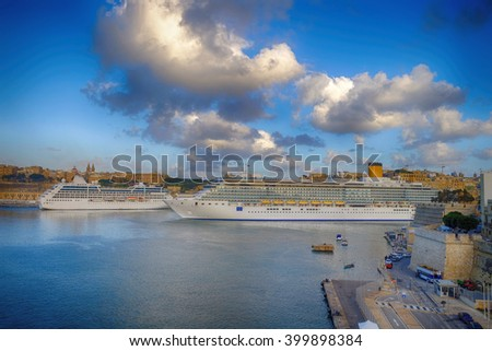 Two cruise ships at the grand harbor of Valletta, Malta - stock photo