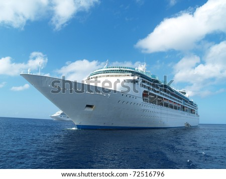 Two cruise ships in caribbean waters - stock photo