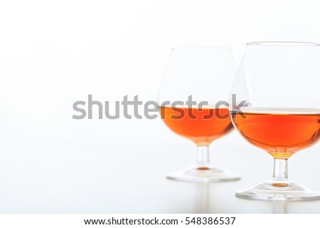 Two crystal cognac glasses on white background