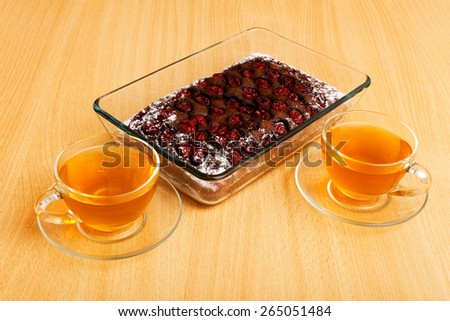 Two cup of tea and brownie - chocolate pie with cherry - stock photo