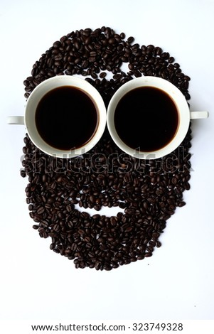 Two cups of black coffee with man face - stock photo