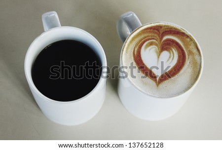 two cups of coffee for man and for woman - stock photo