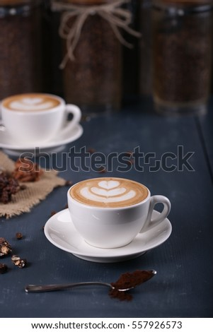Two cups of coffee on a blue background