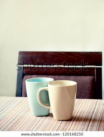 two cups of coffee on a table - stock photo