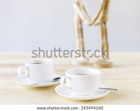 two cups of coffee on table. - stock photo