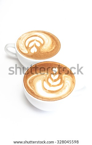 Two cups of coffee on white background - stock photo