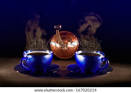 Two cups of coffee soaring on black background - stock photo