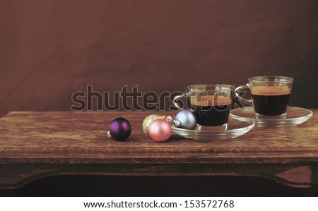 two cups of coffee with christmas balls
