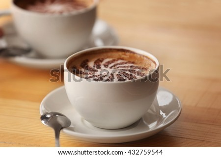 Two cups of coffee with foam, closeup