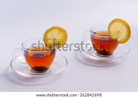 Two cups of delicious tea with lemon. - stock photo
