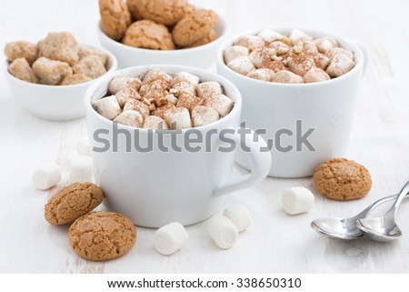 two cups of flavored cocoa with marshmallow and cookies, closeup, horizontal - stock photo