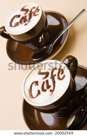 Two cups of fresh cappuccino on a table