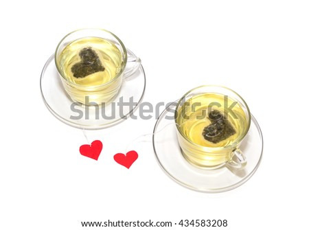 Two cups of green tea with hearts