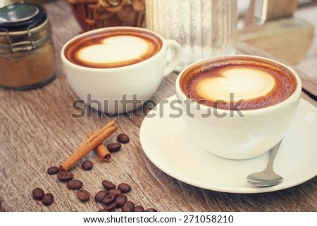 Two cups of latte art coffee - stock photo