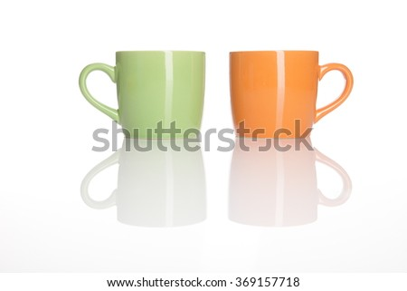 two cups standing on white background  - stock photo