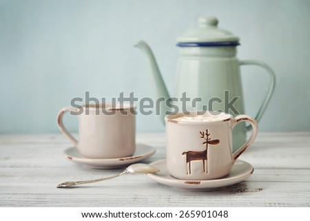Two cups with hot chocolate and marshmallows on wooden table - stock photo
