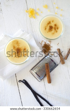 two custard puddings flavored with cinnamon, mastic,vanilla and saffron - stock photo
