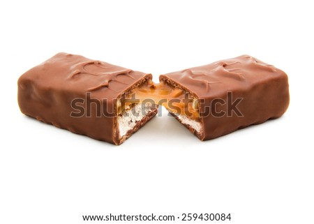 Two cut halves of chocolate bar isolated on white background - stock photo