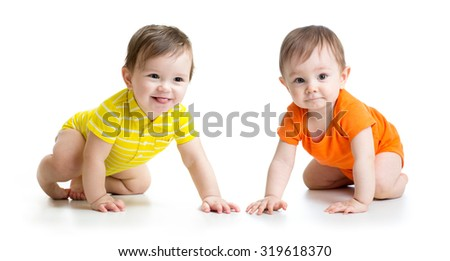 Two cute babies boys crawling on floor. Toddlers isolated on white background. - stock photo