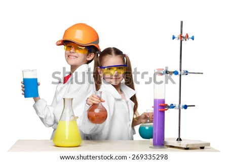 Two cute children at chemistry lesson making experiments isolated on white background - stock photo