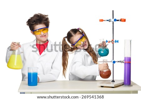 Two cute children at chemistry lesson making experiments isolated on white background