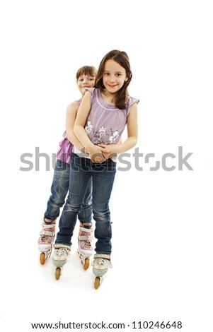 Two cute girls holding hands wearing roller skates. Isolated on a white background
