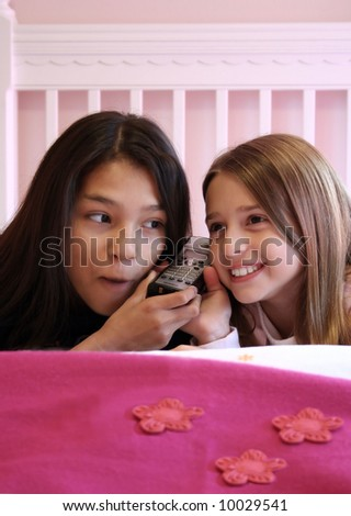 Two cute girls on the phone - stock photo