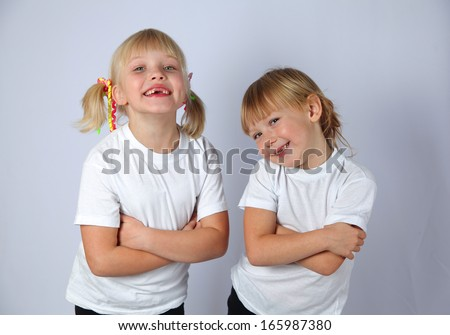 two cute girls posing and smiling - stock photo
