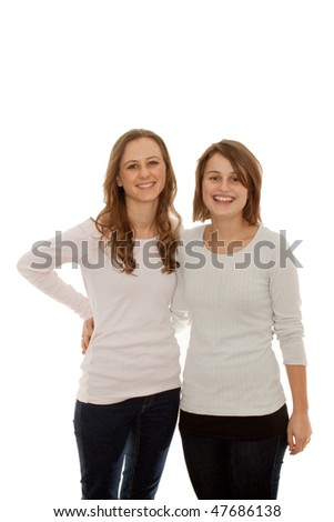 Two cute happy girls smiling at you  on white background