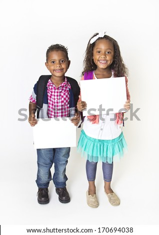 Two cute kids holding up a blank sign - stock photo