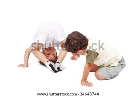 Two cute kids playing together isolated in white