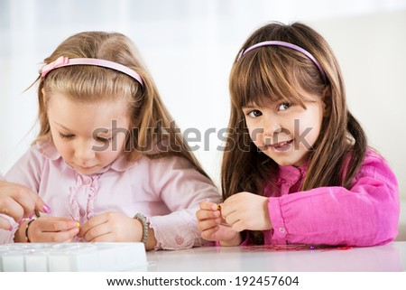 Two cute little girls playing at home