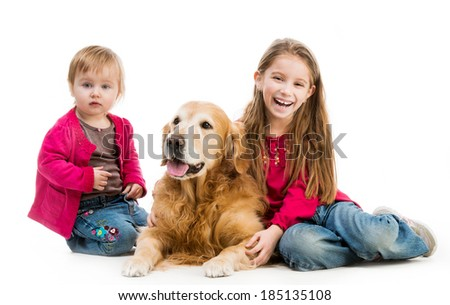 two cute little girls with a red retriever isolated on white background - stock photo