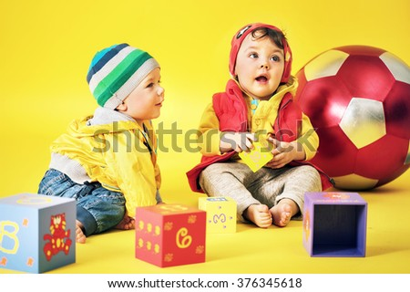Two cute little kids playing