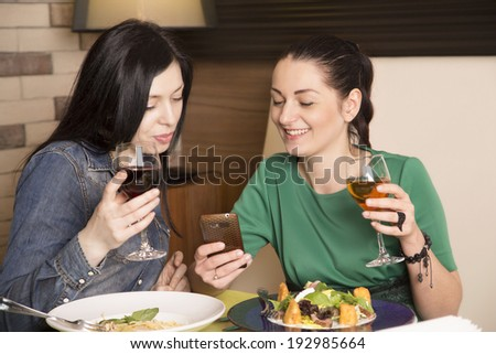 Two cute women having coffee break - stock photo